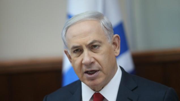 رئيس الوزراء بنيامين نتنياهو يتحدث خلال اجتماع الكابينت الاسبوعي يوم الاحد 9 نوفمبر 2014 Alex Kolomoisky/POOL