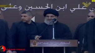 حسن نصرالله زعيم حزب الله مع حراسه (من شاشة اليوتوب)