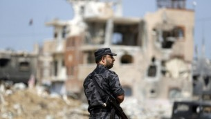 ضابط امن فلسطيني من حماس في غزة، 9 اكتوبر 2014 (AFP/Mohammed Abed)