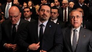 رئيس الوزراء اللبناني السابق سعد الحريري مع رئيس الوزراء اللبناني تمام سلام والرئيس اللبناني السابق ميشال سليمان، في حفل لاحياء الذكرى العاشرة لاغتيال رفيق الحريري 14 فبراير 2015 (ANWAR AMRO / AFP)