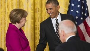 الرئيس الأمريكي باراك أوباما والمستشارة الألمانية أنجيلا ميركل في اعقاب مؤتمر صحفي مشترك في البيت الأبيض في واشنطن، 9 فبراير 2015  AFP/Saul Loeb
