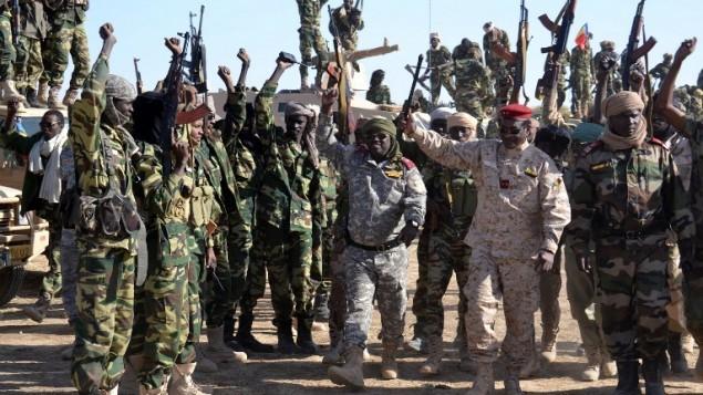 جنود تشاديون في بلدة جامبورو النيجيرية بعد الاستيلاء على البلدة من ايدي بوكو حرام، 1 فبراير 2015 ( AFP/ MARLE)