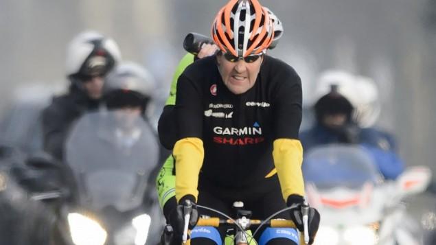 وزير الخارجية الاميركي جون كيري يركب دراجته الهوائية خلال استراحة في لوزان ، 16 مارس 2015 (FABRICE COFFRINI / AFP)