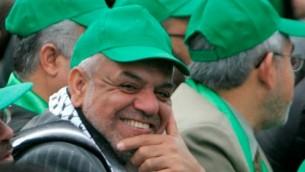 الصحافي مصطفى صواف في مسيرة لحماس في 2011 (صقحة مصطفى صواف على موقع Facebook)