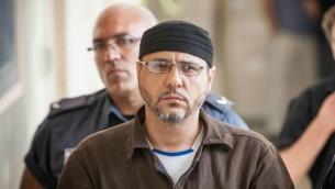 عبد الله البرغوثي في طريقه إلى محكمة الصلح في القدس لإدلاء الشهادة ضمن دعوى مدنية أمريكية ضد القيادة الفلسطينية، في 20 يونيو، 2012. ((Noam Moskowitz/Flash90)