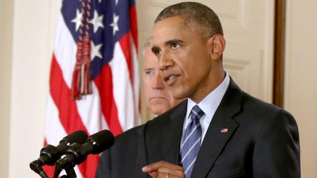 الرئيس الأمريكي باراك أوباما في البيت الأبيض بعد تحقيق الاتفاق النووي مع إيران، 14 يوليو 2015 (ANDREW HARNIK / POOL / AFP)