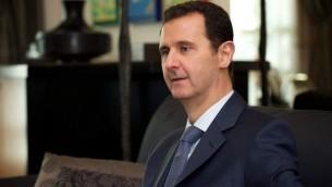 """الرئيس السوري بشار الأسد خلال لقاء معه لمجلة """"فورين أفيرز"""" الأمريكية في دمشق، 26 يوليو، 2015. (AFP)"""