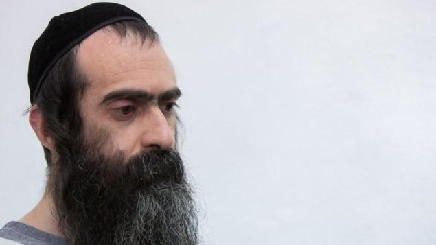 يشاي شليسل، منفذ هجوم الطعن في موكب الفخر في القدس، في محكمة الصلح في القدس، 5 اغسطس 2015 (Yonatan Sindel/Flash90)