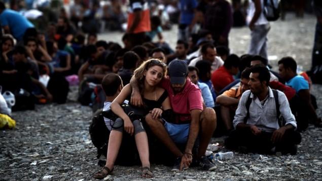 لاجؤون سوريون في اوروبا (ARIS MESSINIS / AFP)