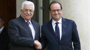 رئيس السلطة الفلسطينية محمود عباس يلتقي بالرئيس الفرنسي فرنسوا هولاند في باريس، 22 سبتمبر 2015 (PATRICK KOVARIK / AFP)