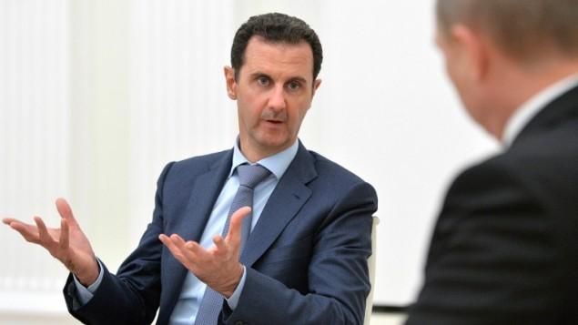 الرئيس السوري بشار الأسد خلال لقائه مع نظيره الروسي فلايديمير بوتين في الكرملين في موسكو، 20 اكتوبر 2015 (ALEXEY DRUZHININ / RIA NOVOSTI / AFP)