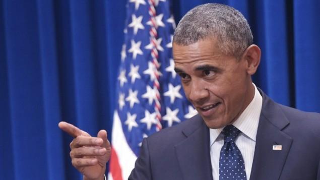 الرئيس الأمريكي باراك أوباما يتحدث إلى مشرعين ديمقراطيين  في مبنى مكتب آيزنهاور  التنفيذي، بالقرب من البيت الأبيض، في 30 سبتبمر، 2015، في العاصمة واشنطن. (AFP PHOTO/MANDEL NGAN)