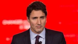 رئيس الحزب الليبرالي الكندي جاستن ترودو بعد الفوز برئاسة الوزراء في البلاد، 20 اكتوبر 2015 (NICHOLAS KAMM / AFP)