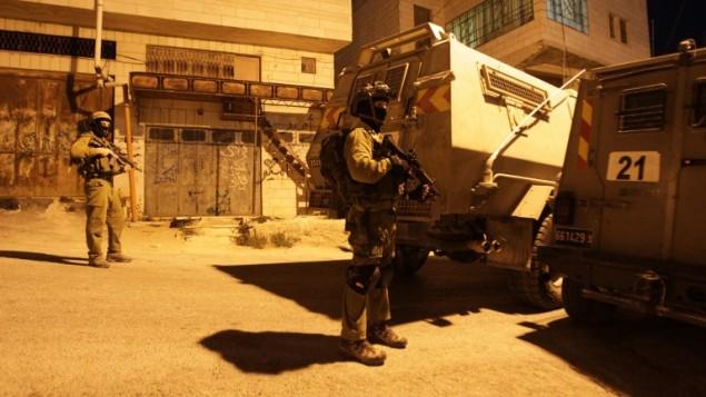صورة توضيحية لجنود اسرائيليين في الضفة الغربية، 15 يونيو 2014 (AFP/Hazem Bader)