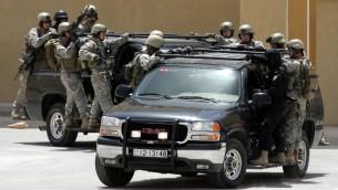 (ارشيف) قوات خاصة اردنية وأمريكية خلال تدريب مشترك بالقرب من عمان، 19 مايو 2009 (KHALIL MAZRAAWI / AFP)