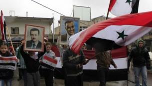 صورة توضيحية: مسيرة للدرزو دعما للرئيس السوري بشار الأسد في بلدة مجدل شمس في هضبة الجولان. (Tsafrir Abayov/Flash90/File)