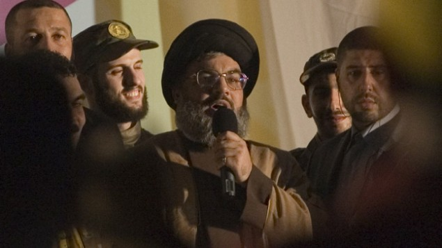 الأمين العام لحزب الله حسن نصر الله، في الوسط، يتحدث أمام جمهور في ظهور علني نادر في 16 يوليو، 2008. (photo credit: Ferran Queved/flash90)