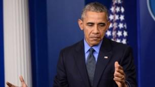 الرئيس الأمريكي باراك أوباما يتحدث خلال مؤتمر صحفي في قاعة المؤتمرات في البيت الأبيض في العاصمة واشنطن، 18 ديسمبر، 2015. (Photo by AFP/Andrew Caballero-Reynolds)