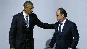 الرئيس الأمريكي باراك اوباما والرئيس الفرنسي فرانسوا هولاند خلال مؤتمر المناخ في باريس، 30 نوفمبر 2015 (IAN LANGSDON / POOL / AFP)