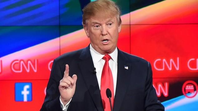 المرشح عن الحزب الجمهوري في الانتخابات الأمريكية دونالد ترامب خلال مناظرة على قناة سي ان ان، 15 ديسمبر 2015 (ROBYN BECK / AFP)