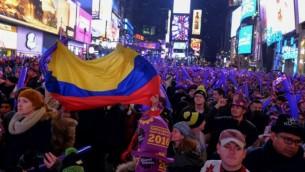 احتفالات عيد رأس السنة في ساحة تايمز سكوير في نيويورك، 31 ديسمبر 2015 (Eduardo Munoz Alvarez/Getty Images/AFP)