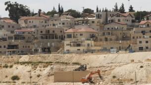 صورة توضيحية لموقع أعمال بناء في مستوطنة تقوع في الضفة الغربية، 7 سبتمبر، 2014. (Flash90)