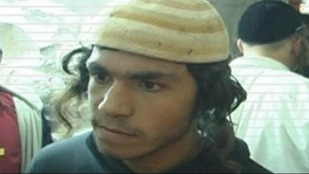 عميرام بن اولئيل، الذي تم توجيه لائحة اتهام ضده في 3 يناير 2016، في قضية قتل افراد عائلة دوابشة في دوما (courtesy)