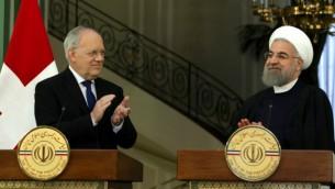 الرئيس الإيراني حسن روحاني (من اليمين) ونظيره السويسري يوهان شنايدر يتحدثان خلال مءتمر صحفي بعد لقاء جمعهما في طهران، 27 فبراير، 2016. (Atta Kenare/AFP)