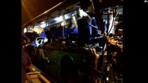 A bus involved in a fatal accident on Route 1 (screen capture: Channel 2)