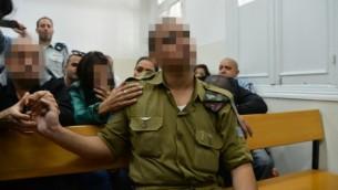 الجندي الإسرائيلي الذي أطلق النار على منفذ هجوم خلال جلسة في المحكمة العسكرية في يافا، 14 أبريل، 2016. (Flash90)