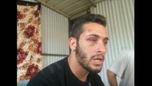 صورة لميسم أبو القيعان تم التقاطها بعد أن قام رجال شرطة بزي مدني بضربه خلال عملية إعتقال في تل أبيب، 22 مايو، 2016. (لقطة شاشة: YouTube)