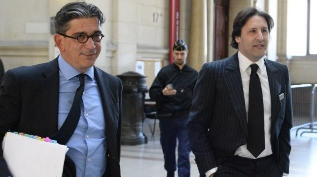 أندرو ميمران (من اليسار) يصل برفقة محاميه جان مارك فديدا  (من اليمين) إلى محكمة باريس، في 25 مايو، 2016، لحضور محاكمته في قضية احتيال بقيمة 238 مليون يورو (AFP PHOTO / BERTRAND GUAY)