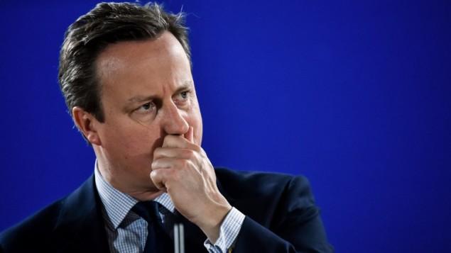 رئيس الوزراء البريطاني ديغيد كاميرون خلال لقائه لكلمة في مؤتمر صحفي خلال قمة للإتحاد الأأوروبي في 28 يونيو، 2016، في مقر الإتحاد الأوروبي في بروكسل. (AFP PHOTO/PHILIPPE HUGUEN)