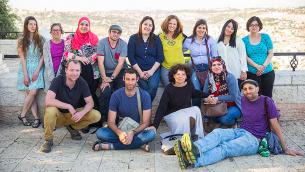 """المعلمون ال15 الذين يشاركون في مشروع التعايش """"غرفة المعلمين""""، الذي يتضمن صوار يتم عرضها حاليا في مبنى  YMCA في القدس. (Courtesy Dana Talel)"""