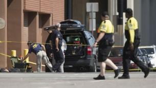 شرطة توضيحية لعناصر شرطة في دالاس في ولاية تكساس. (AFP/Laura Buckman)
