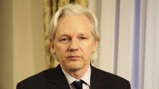 In this July 30, 2013 file photo released by Sunshine Press Productions, WikiLeaks founder Julian Assange sits inside the Ecuadorian Embassy in London. AP/Sunshine Press Productions, File