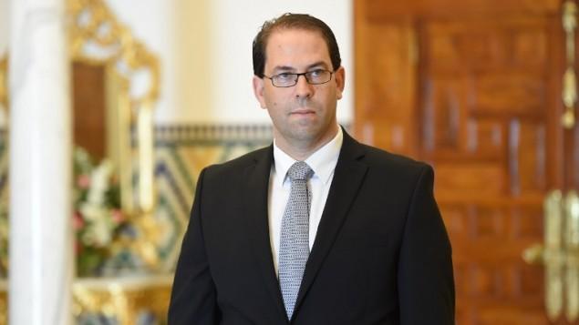 يوسف الشاهد، أصغر سياسي يُكلف ترؤس حكومة في تاريخ تونس منذ استقلالها عن فرنسا، في قصر قرطاج، تونس، 3 اغسطس 2016 (FETHI BELAID / AFP)