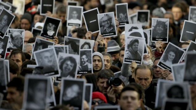 People hold up pictures of those who died in the AMIA Jewish center bombing that killed 85 people as they commemorate the attack's 22nd anniversary in Buenos Aires, Argentina, July 18, 2016. AP Photo/Natacha Pisarenko