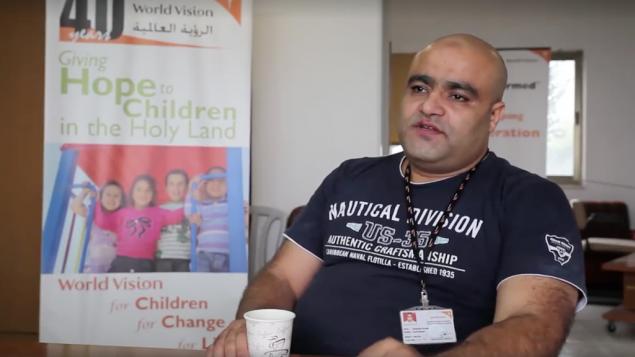 محمد حلبي، عضو في حماي ومدير عمليات جمعية World Vision الخيرية في قطاع غزة، تم اتهامه في 4 اغسس بتحويل اموال الجمعية لحركة حماس (Screen capture: World Vision)