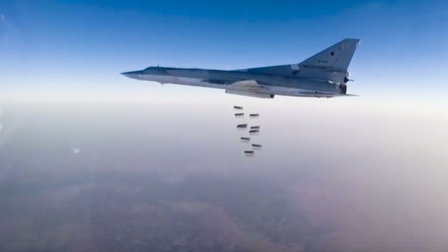 A Russian long range bomber Tu-22M3 flies during a strike above an undisclosed location in Syria on Sunday, Aug. 14, 2015. ( Russian Defense Ministry press service photo via AP)