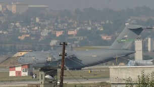 A United States Air Force cargo plane maneuvers on the runway after it landed at the Incirlik Air Base, in Adana, southern Turkey, Sunday, Aug. 9, 2015. AP Photo