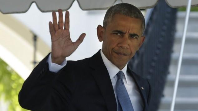 الرئيس الأمريكي باراك أوباما  خلال خروجه من البيت الأبيض في العاصمة واشنطن، قبل مغادرته إلى قمة قادة أمريكا الشمالية في أوتاوا في 29 يونيو، 2016. (AFP Photo/Yuri Gripas)