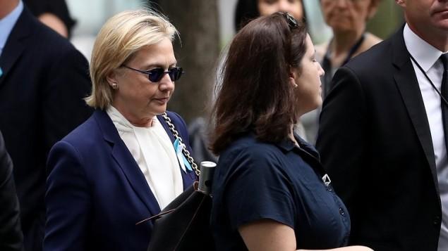 المرشحة الديمقراطية للانتخابات الامريكية هيلاري كلينتون تصل الى مراسيم ذكرى اعتداءات 11 سبتمبر في نيويورك، 11 سبتمبر 2016 (Justin Sullivan/Getty Images/AFP)