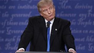 المرشح الجمهوري للرئاسة الامريكية دونالد ترامب خلال المناظرة الرئاسية الاولى التي أجريت في جامعة 'هوفسترا' في همبستيرد، نيويورك، 26 سبتمبر، 2016 (Win McNamee/Getty Images/AFP)