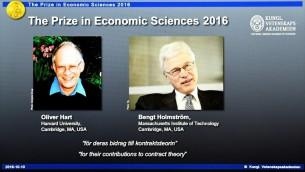 صور عالمي الاقتصاد الاميركي البريطاني اوليفر هارت والفنلندي بنغت هلومستروم الفائزان بجائزة نوبل للاقتصاد على الشاشة خلال مؤتمر صحفي للاعلان عن الفائزين، 10 اكتوبر 2016 (AFP PHOTO / JONATHAN NACKSTRAND)