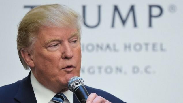 المرشح الجمهوري للرئاسة الامريكية دونالد ترامب خلال حفل افتتاح فندق ترامب انترناشيونال في واشنطن، 26 اكتوبر 2016 (MANDEL NGAN / AFP)
