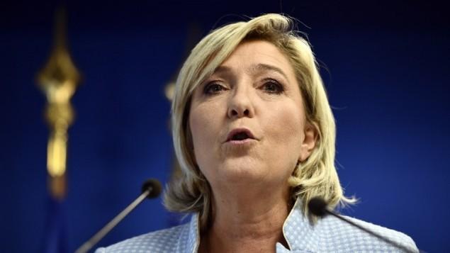 زعيمة الجبهة الوطنية والمرشحة للانتخابات الرئاسية الفرنسية لعام 2017 مارين لوبن خلال مؤتمر صحفي في مقر الحزب، 9 نوفمبر 2016 (MARTIN BUREAU / AFP)