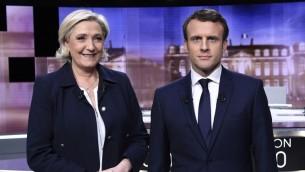 المرشحين للانتخابات الرئاسية الفرنسية مارين لوبن وايمانويل ماكرون قبل المناظرة التلفزيونية بينهما، 3 مايو 2017 (ERIC FEFERBERG / POOL / AFP)