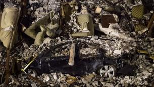 سيارة وأرائك مكسورة تحت كومة من الأنقاض من مبنى انهار في مكسيكو في 21 سبتمبر 2017، بعد يومين من زلزال قوي ضرب وسط المكسيك. (AFP/PEDRO PARDO)