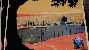 """نسخة جديدة  لملصق """"زر فلسطين"""" الشهير تظهر المسيح، يوسف ومريم ممنوعين من دخول القدس بسبب الجدار الامني الاسرائيلي. (Judah Ari Gross / Times of Israel)"""